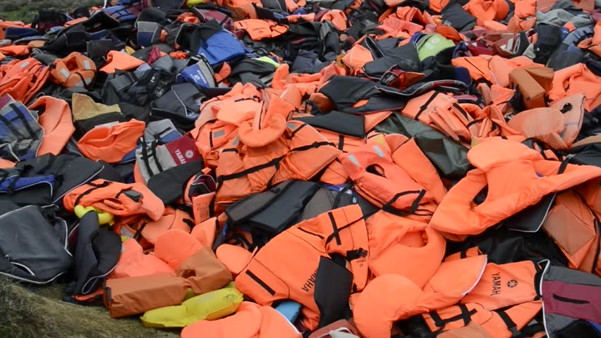 LESVOS, GREECE March 16, 2016: Mountain of Lifejackets left by refugees. These Syrian, Afghanistan and African refugees land their boat at the coast of Lesvos near Molivos, Eftalou | Shutterstock HD Video #15335866