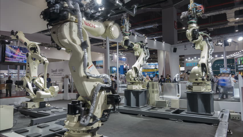 SHANGHAI, CHINA - NOVEMBER 2015: Time lapse of production robots assembling cars at a modern technology exhibition in Shanghai, China