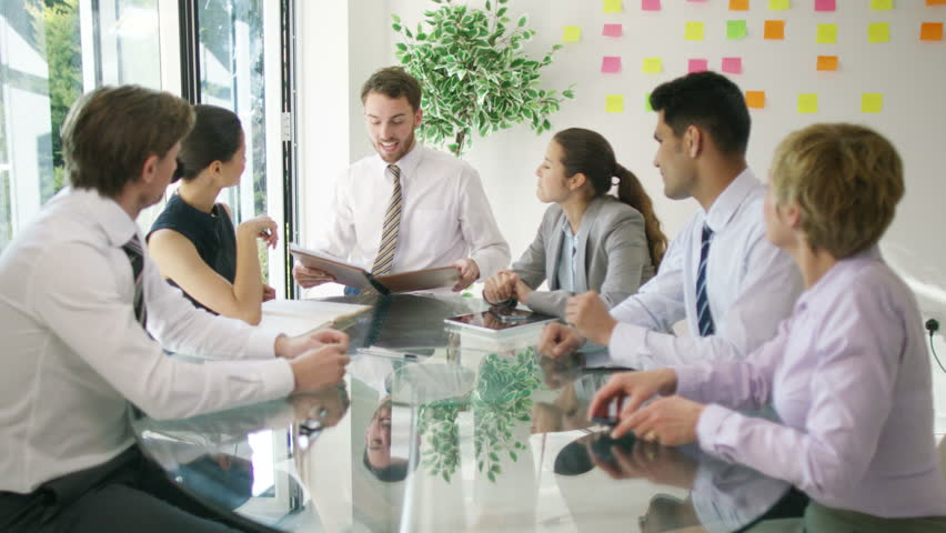 4K Corporate business group in a meeting looking over the company figures | Shutterstock HD Video #15350122