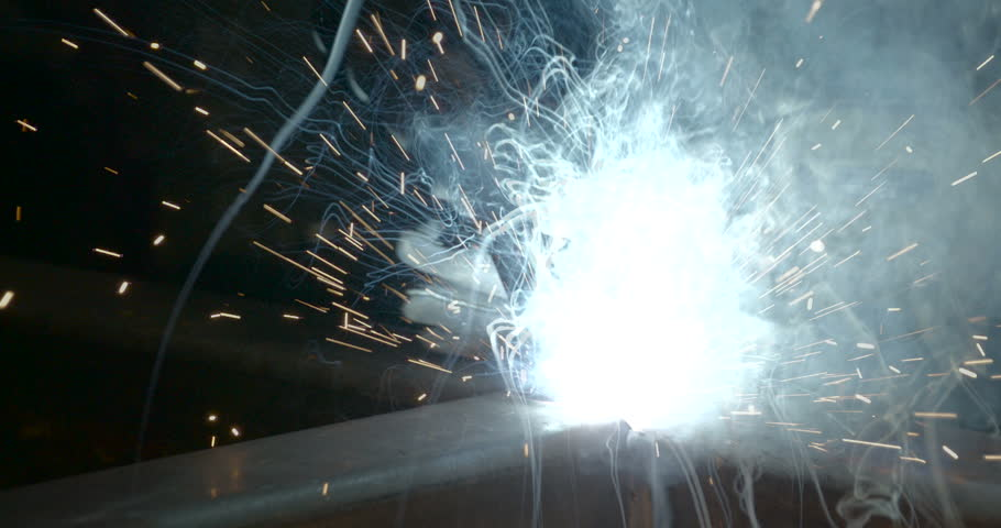 Lights coming from the welding machines. The machine being used by a worker with protective gears | Shutterstock HD Video #15358036