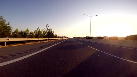 Driving car at sunset on highway A6 between Limassol and Paphos, Cyprus - POV