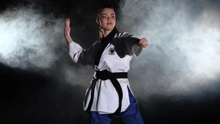 Karate demonstration performance. Black #15365686