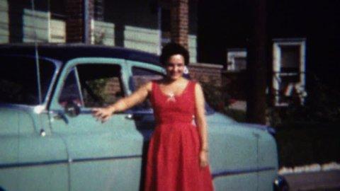ROME, ITALY 1954: Italian American women drives classic teal Oldsmobile car.