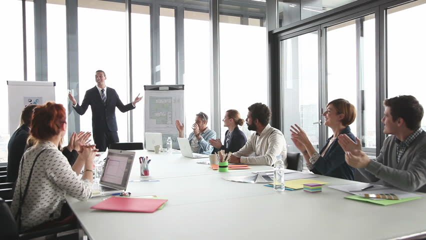 Colleagues applauding director during a meeting in conference room | Shutterstock HD Video #15414676