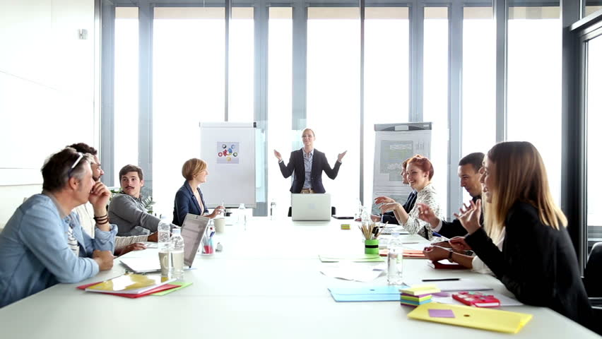 Happy business people clapping after presentation of their female colleague, graded | Shutterstock HD Video #15415276