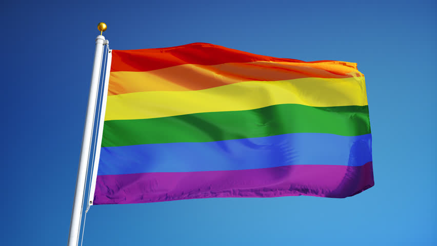 Slow Motion Of Rainbow Flag Waving Against Blue Sky Commonly The Gay Pride Flag And -9411