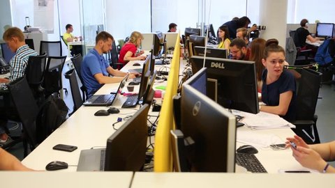 MOSCOW - JUN 03, 2015: Many people work with computers in Tinkoff Bank office. Tinkoff Bank - only full online bank in Russia