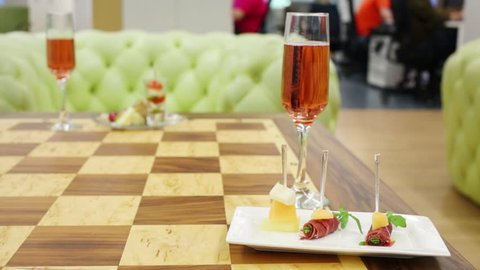Canapes cold dishes and glass with Sparkling rose wine