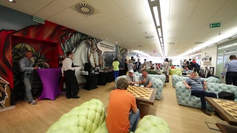MOSCOW - JUN 03, 2015: People in rest zone of office. Tinkoff Credit Systems is first Russian bank that has completely refused from branch of bank