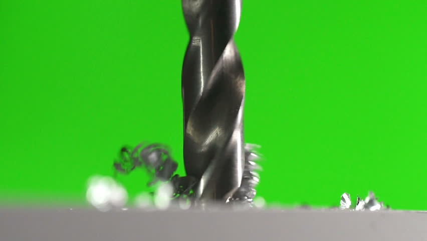 The drill bit make a hole in the metal on a green background. Slow motion | Shutterstock HD Video #15451636