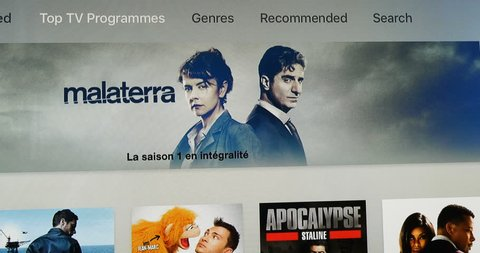 PARIS, FRANCE - CIRCA 2016: Browsing through latest Apple TV digital media box device displaying the most watched movies and series at the moment from South-Park to Borgen
