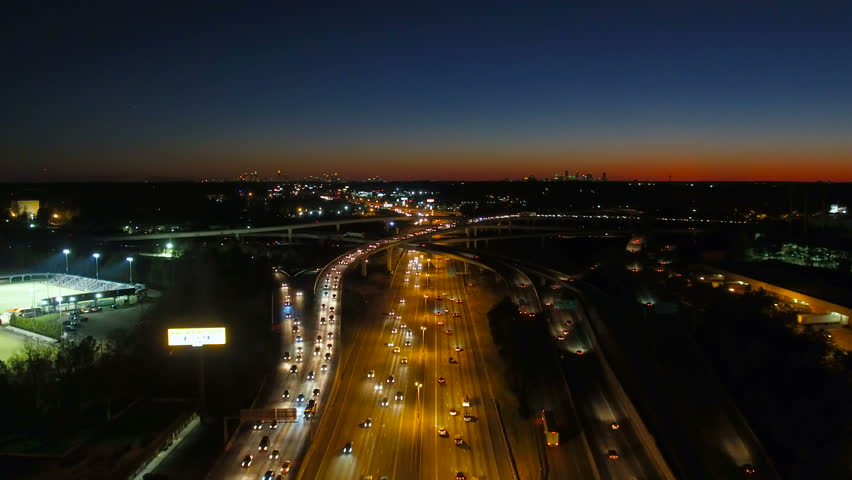 Atlanta Aerial v234 Flying low following over Spaghetti Junction freeways with cityscape night views.