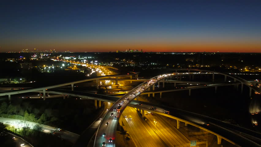 Atlanta Aerial v235 Flying low over Spaghetti Junction freeways panning with cityscape night views.