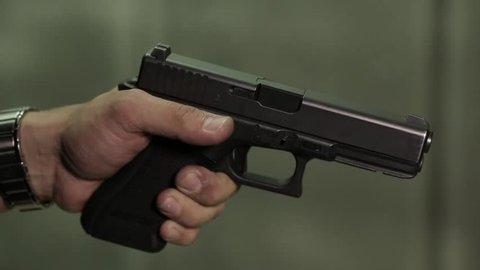 Shot of A gun being cocked close up