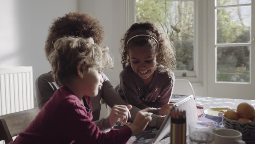Mother video call with children and father on digital tablet | Shutterstock HD Video #15515056