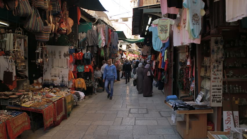 A tracking shot moving through the narrow streets of the Arab Quarter in Jerusalem/ Arab Quarter Shops