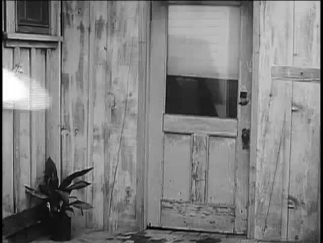 Two cowboys dragging man into sheriff\u0027s office 1940s - SD stock video clip & Rear View Of Cowboy Kicking In Wooden Door 1940s Stock Footage ...