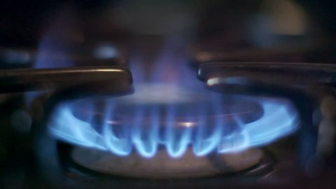Stove top burner igniting into a blue cooking flame in slow motion 180fps. See my portfolio for other angles and slow motion speeds (60fps-180fps), including 4K UHD.