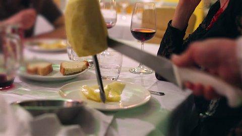 Pineapple slices with sword on set table in Brazilian Steakhouse Restaurant