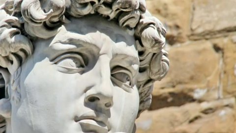 Detail close-up of Michelangelo's David statue  with place for your design or text and the left video camera motion