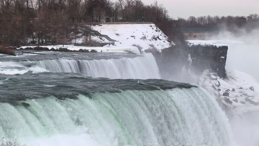Water rushes over Niagara Falls in winter