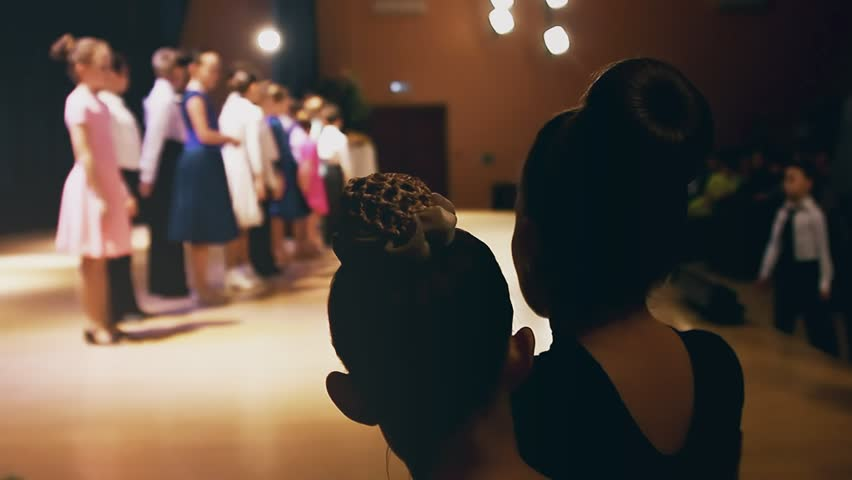 Young  girls watching dancers ballroom dancing on stage concert | Shutterstock HD Video #15628378