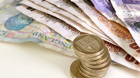 Closeup of British currency. Sterling notes and coins.