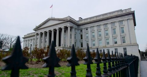 United States Department of the Treasury building with fence. 4K wide shot. Use as a digital zoom. Also available in 4K HDR. This building is on the back of the $10 US Bill.