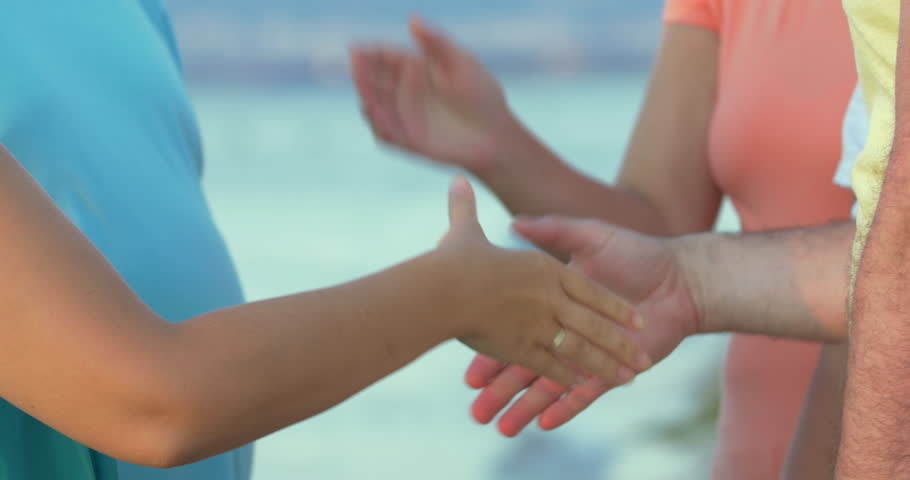 Group of undefined people is shaking hands of each other.   Shutterstock HD Video #15671179