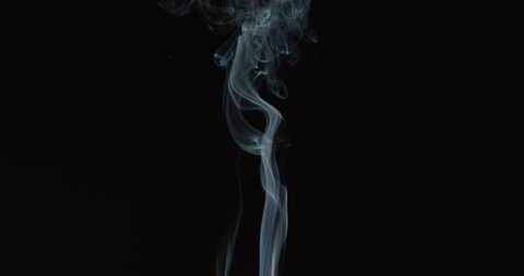 Magical wisps of smoke rise from bottom of frame as if from candle or fire against black background, ALPHA MATTE