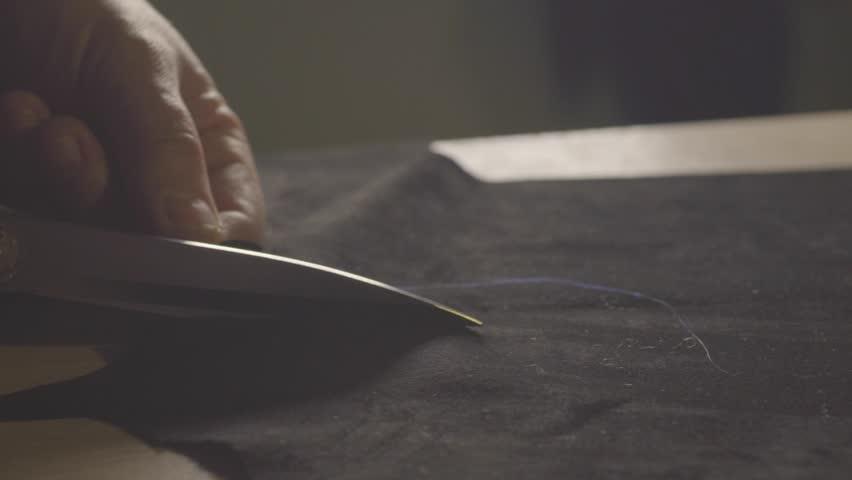 Dressmaker cutting fabric | Shutterstock HD Video #15688336