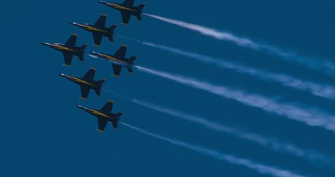 NORTH KINGSTOWN, RHODE ISLAND - CIRCA JUNE 2014:  Navy Blue Angels demonstration team in F18 Hornet fighter jets performing during air show. Jets flying togetherthen going in different directions. 4K.