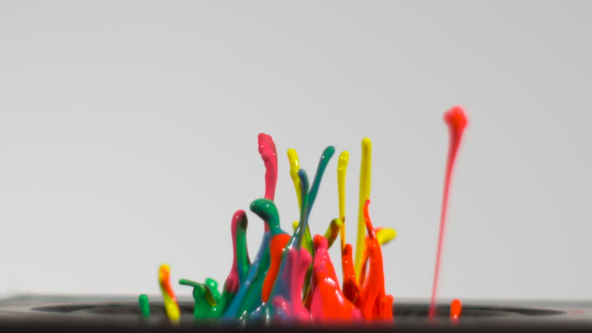 Streams of wet blue green orange and yellow neon paint splash up from a speaker thumping in slow motion and blend into beautiful artistic designs, isolated on white, wider shot with speaker visible | Shutterstock HD Video #15697036