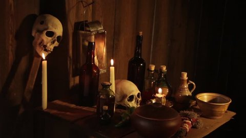 VIRGINIA - SUMMER 2015 - Re-enactment recreation of historical, 18th & 19th century African/Caribbean VooDoo black arts and religious ceremony symbols - skulls, skeletons and candles. Potions, spells