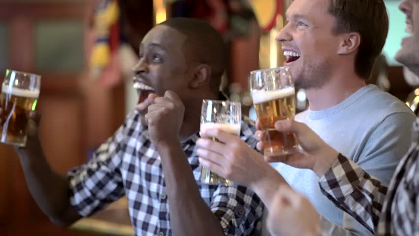Young man in a bar with beer | Shutterstock HD Video #15733366