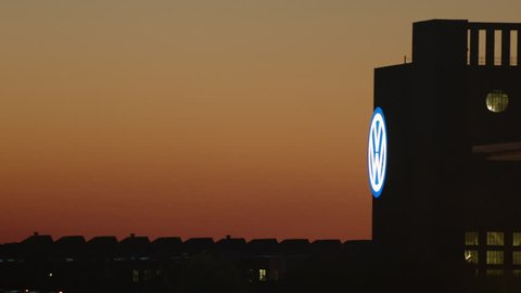 WOLFSBURG, LOWER SAXONY/GERMANY - OCT 11, 2016. Time-lapse night to day of the VW headquarters. The site where the plan to enable VW vehicles to cheat during emissions tests was conceived.