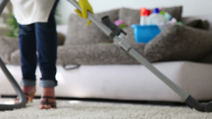 Cleaning the  carpet with vacuum cleaner before couch - close up - detail