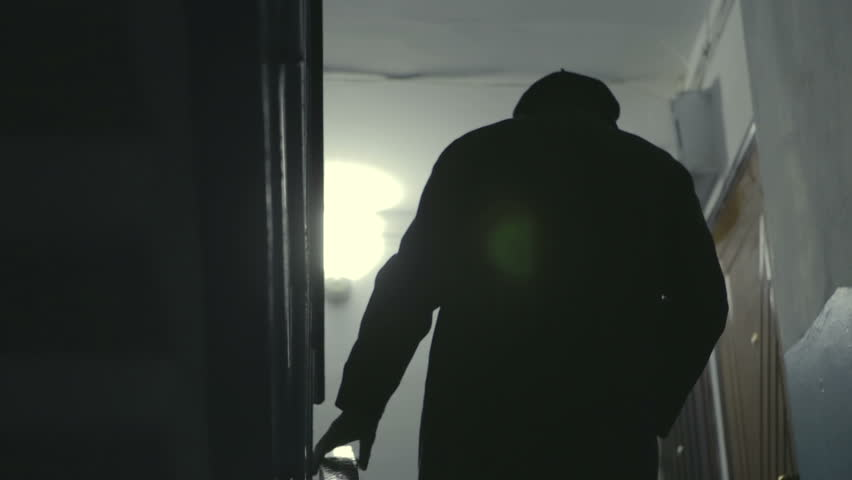 Silhouette old man, it's hard climbs the stairs of an apartment building at night