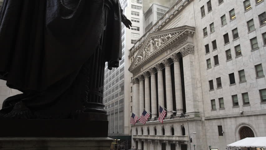 An establishing shot of New York's iconic Wall Street. In the heart of Manhattan's financial district. A hotspot for tourism and finance. New York, NY - March, 2016