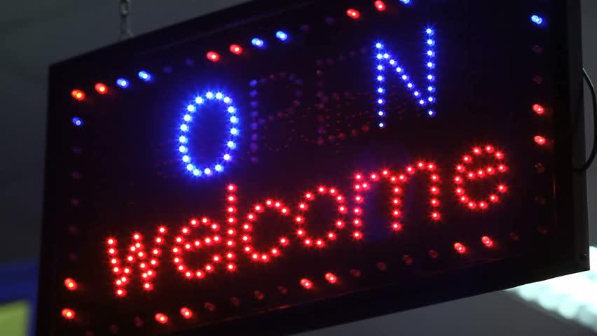 Glowing open neon display sign, rack focus