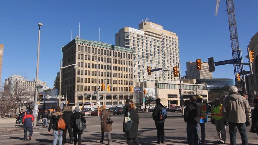OTTAWA, CANADA On MAR 11th: Pedestrians Cross Rideau Street In ...