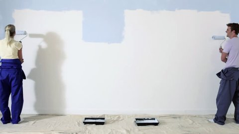 July 15, 2010: Time lapse shot of couple painting a wall