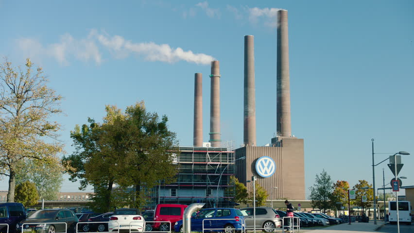 WOLFSBURG, LOWER SAXONY/GERMANY - OCT 12, 2016. Medium shot of an old section of the VW plant with VW logo. The site where the plan to enable VW vehicles to cheat during emissions tests was conceived.