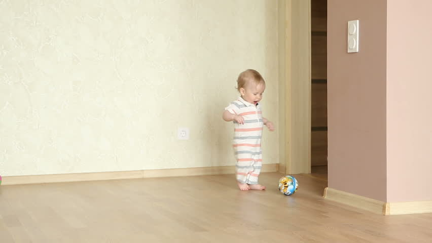 Cute little boy playing with soccer ball at home #15933046
