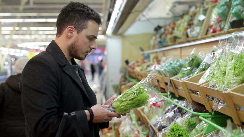 Man chooses products in the supermarket   Shutterstock HD Video #15939271