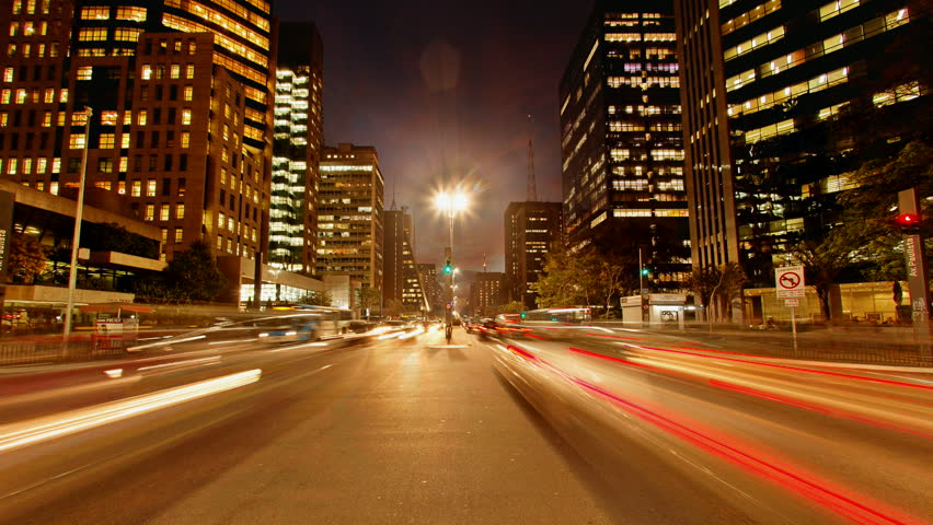 SAO PAULO, BARAZIL - JUNE 29: (Timelapse View) Cars race home at rush hour after work on Avenida Paulista, June 29, 2011 in Sao Paulo, Brazil.