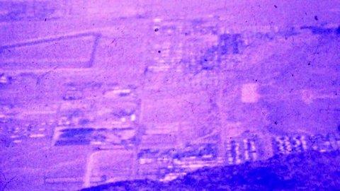 HONOLULU, HAWAII 1964: City skyline grid below mountain overlook view.