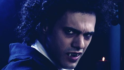 Sad male vampire turning around looking camera angry slow motion dolly shot