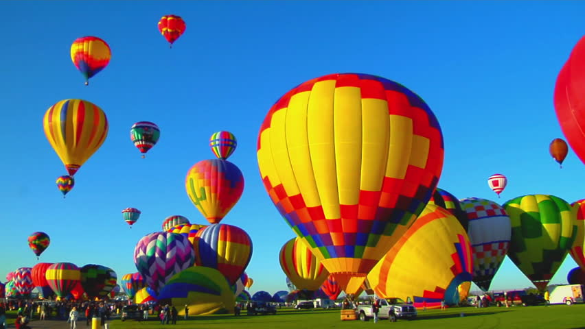 Colorful balloons launch at the Albuquerque Balloon Festival