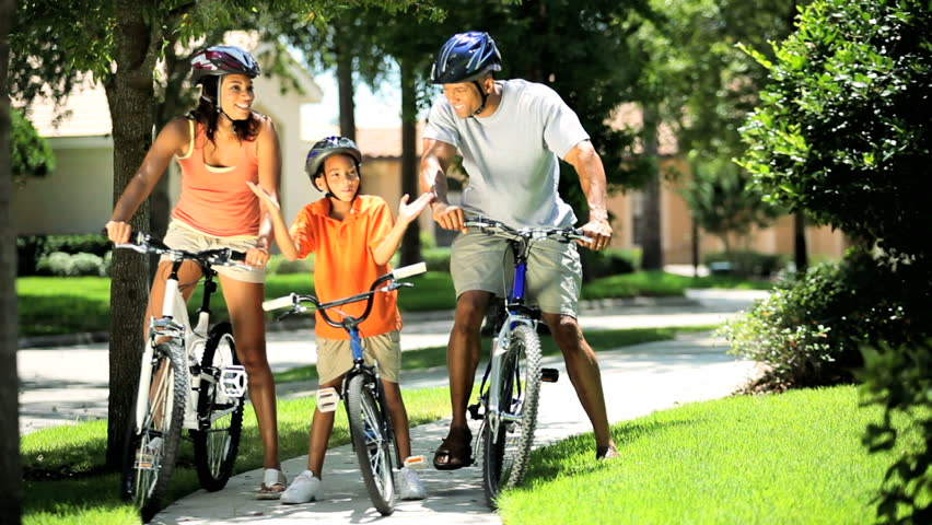 Young Ethnic Family Cycling Together Stock Footage Video 100